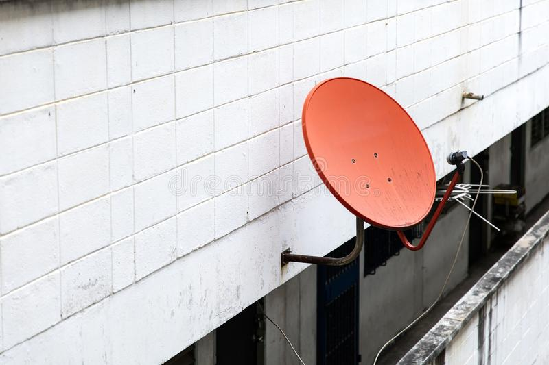 Satellite dish on wall. Antenna apartment architecture black broadcast building cable channel communicate communication connection data design digital stock images