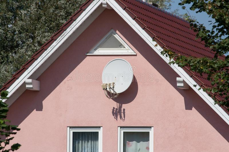 Satellite dish on a wall royalty free stock image