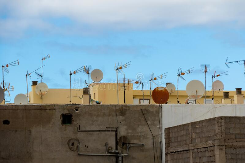 Satellite dishes and analog television antenna stock images