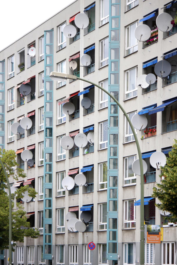 Satellite dishes. CIRCA JUNE 2014 - BERLIN: an appartement house primarily inhabitated by immigrants in the Wedding district of Berlin stock image