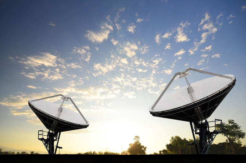 Satellite Dishes for telecommunication. In the morning stock photo