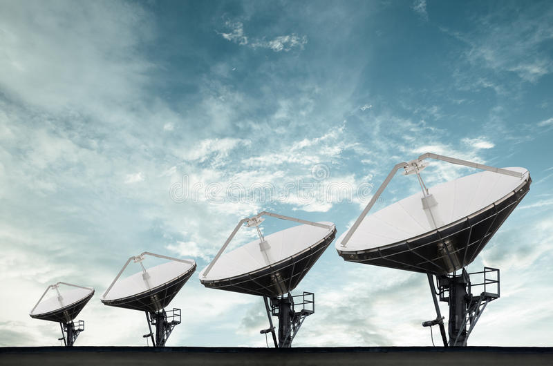Satellite Dishes for telecommunication. Under blue sky stock photography