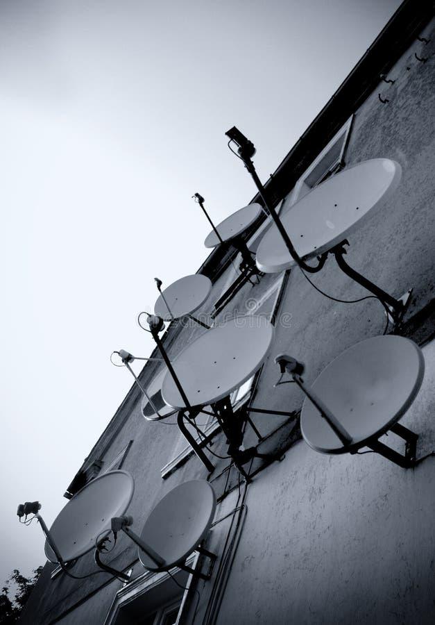 Satellite dishes wall stock photos