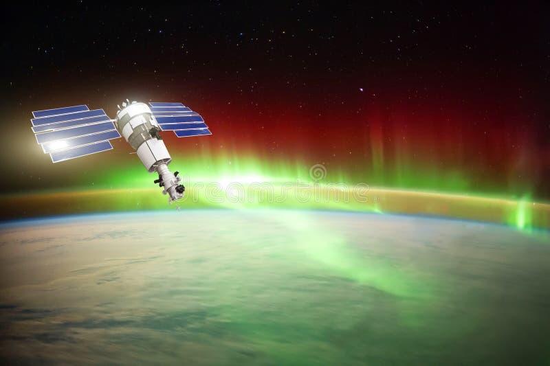 Satellite per l'osservazione dell'aurora borealis in orbita l'orbita terrestre, misurante il flusso delle particelle del sole, il fotografia stock libera da diritti