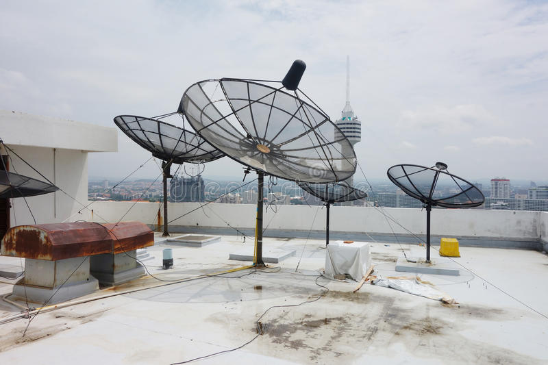 Satellites dishes. Antenna on roof top royalty free stock photography