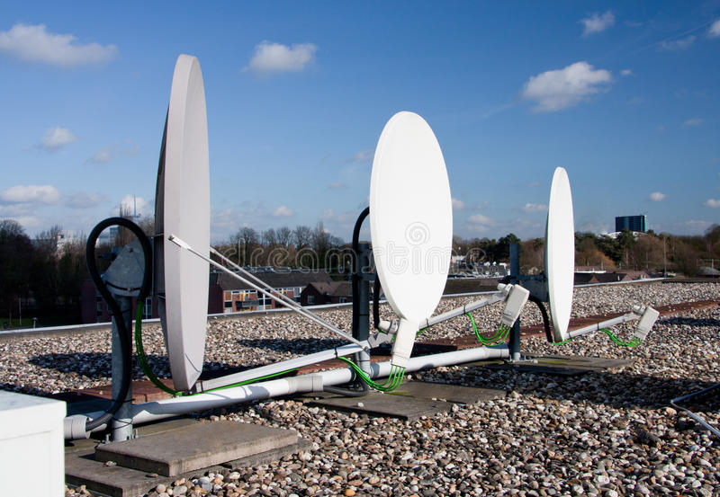 Satellites on a roof stock image