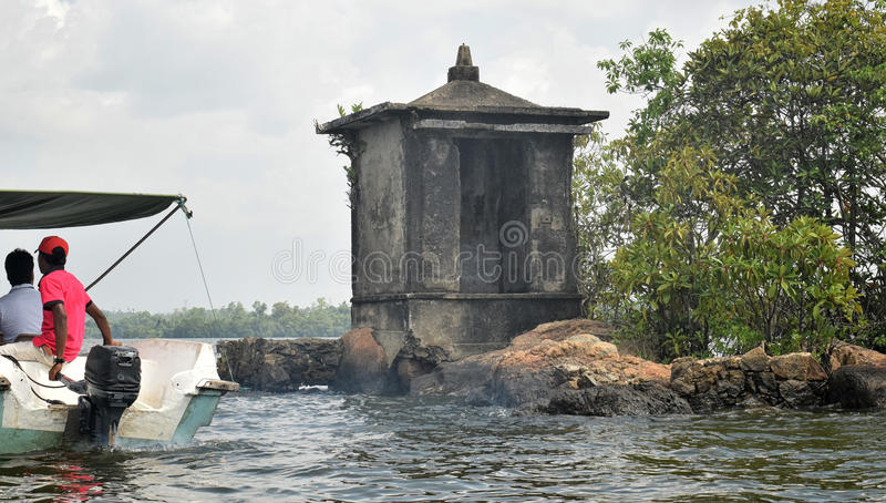 Satha Paha Duwa Madu River. Island got it name because its shape is similar to older 5 cents coin. There is only a small shrine located there stock image