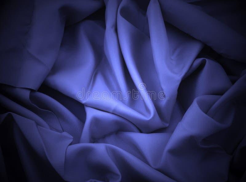 Satin bleu avec le projecteur photo stock