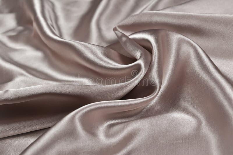 Satin ou soie beige lisse photographie stock libre de droits