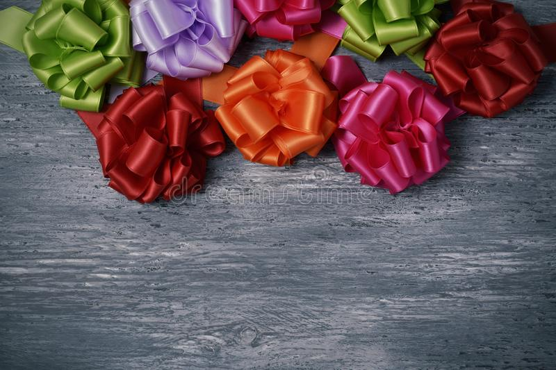 Satin ribbon gift bows of different colors royalty free stock photography