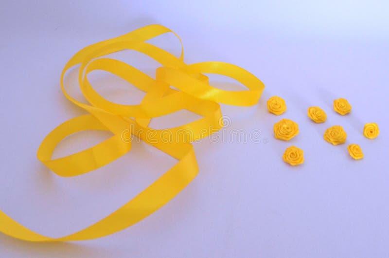 Of satin ribbon roses. Yellow rose of satin ribbon handmade stock image