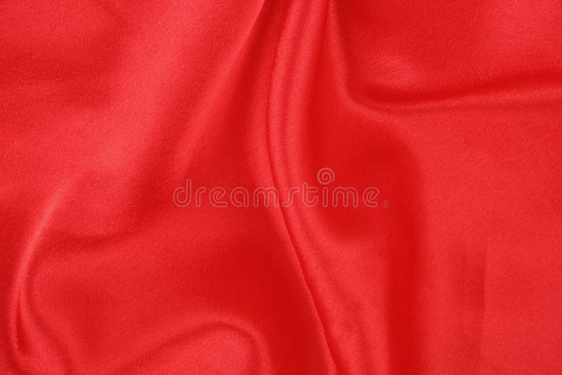 Satin rouge plié photographie stock