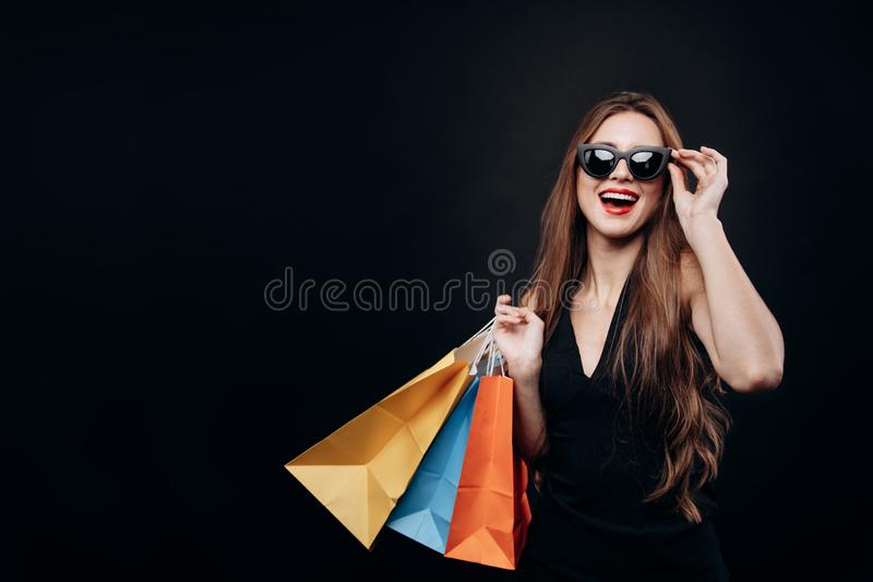 Satisfied Black Friday Customer Girl With Purchases royalty free stock photo