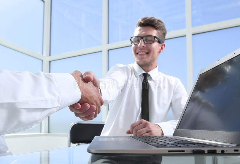 Satisfied entrepreneurs shaking hands after negotiations on meeting in office stock images