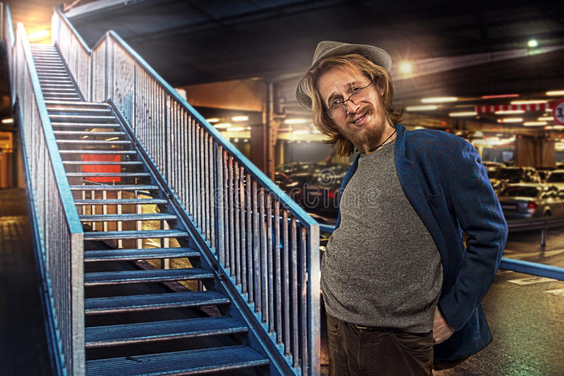 Download Satisfied Funny Man By The Stairs, Underground Parking Lot Background Stock Photo - Image: 37975712