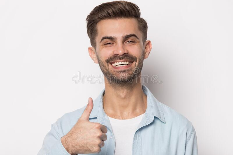 Satisfied happy young male customer recommending product. royalty free stock image