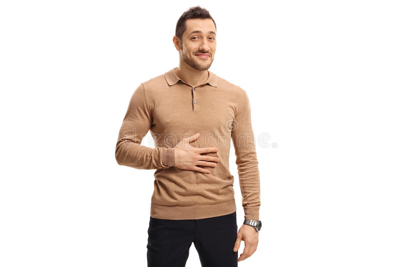 Satisfied man holding his hand on his stomach. After having a meal or a drink isolated on white background stock photo