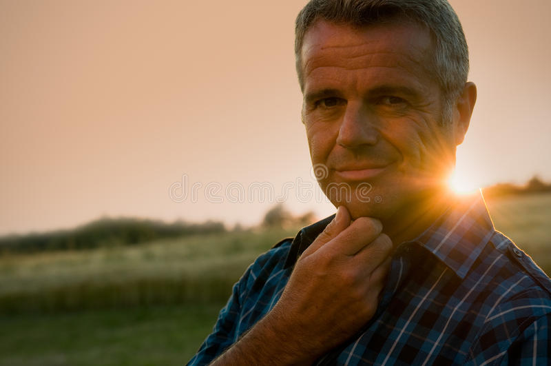 Satisfied mature man outdoor stock images