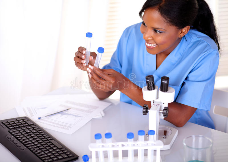 Satisfied Scientific Woman Looking To Test Tube Royalty Free Stock Image