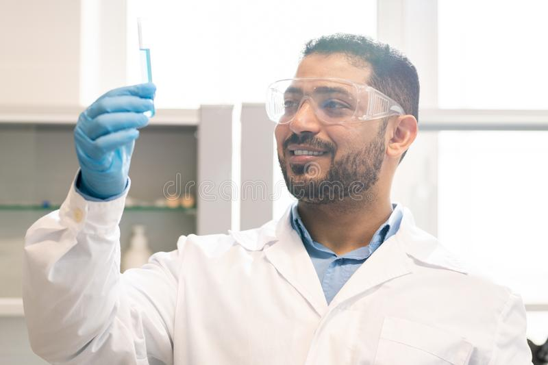Satisfied scientist inventing medication stock photo