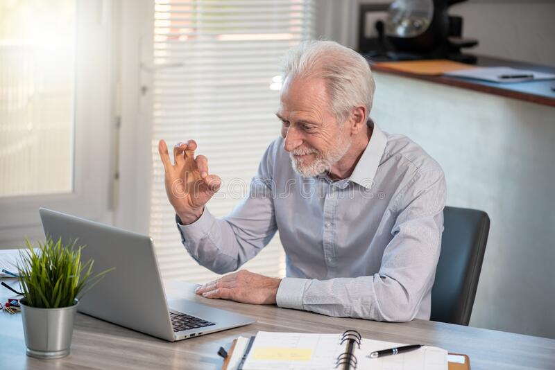 Satisfied senior businessman stock photos