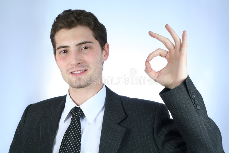 Satisfied white-collar worker with stock image