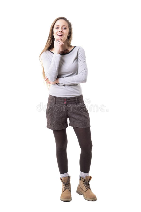 Satisfied young cute woman judging analyzing and smiling with approval and admiration looking at camera. Full body isolated on white background stock photography
