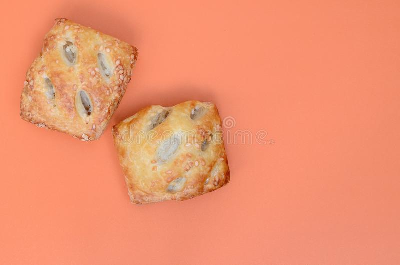 A satisfying meat patty, which combines an airy puff pastry and. A delicate pork filling with onions. Baking on an orange background royalty free stock photo