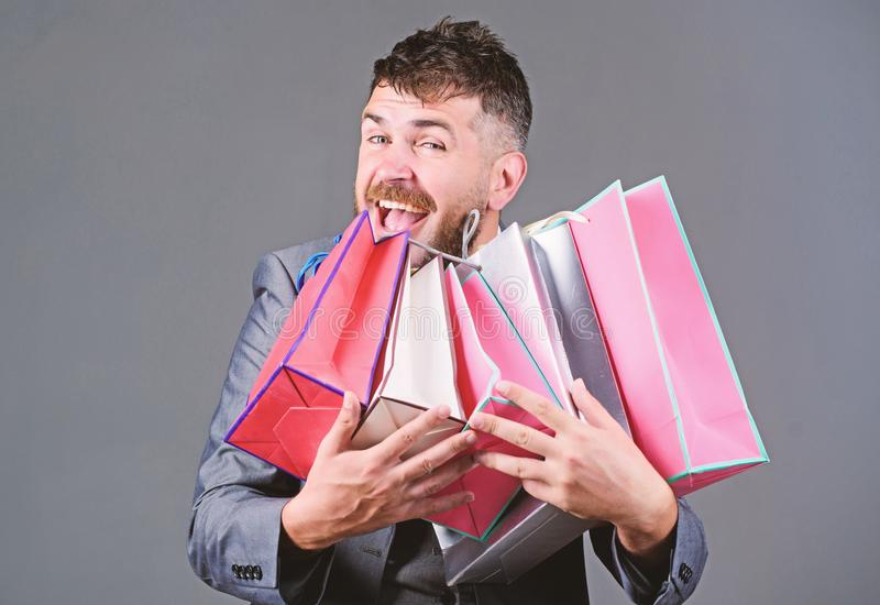 Satisfying shopping tour. Man bearded businessman customer carry many shopping bags. Enjoy shopping profitable deals royalty free stock photography