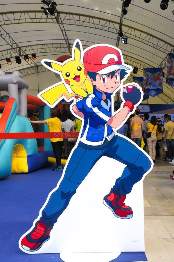 Satoshi e Pikachu Di tagliati per la cabina della foto sull'evento di giorno di Pokemon in tenda all'aperto a Siam Paragon, organ fotografie stock libere da diritti