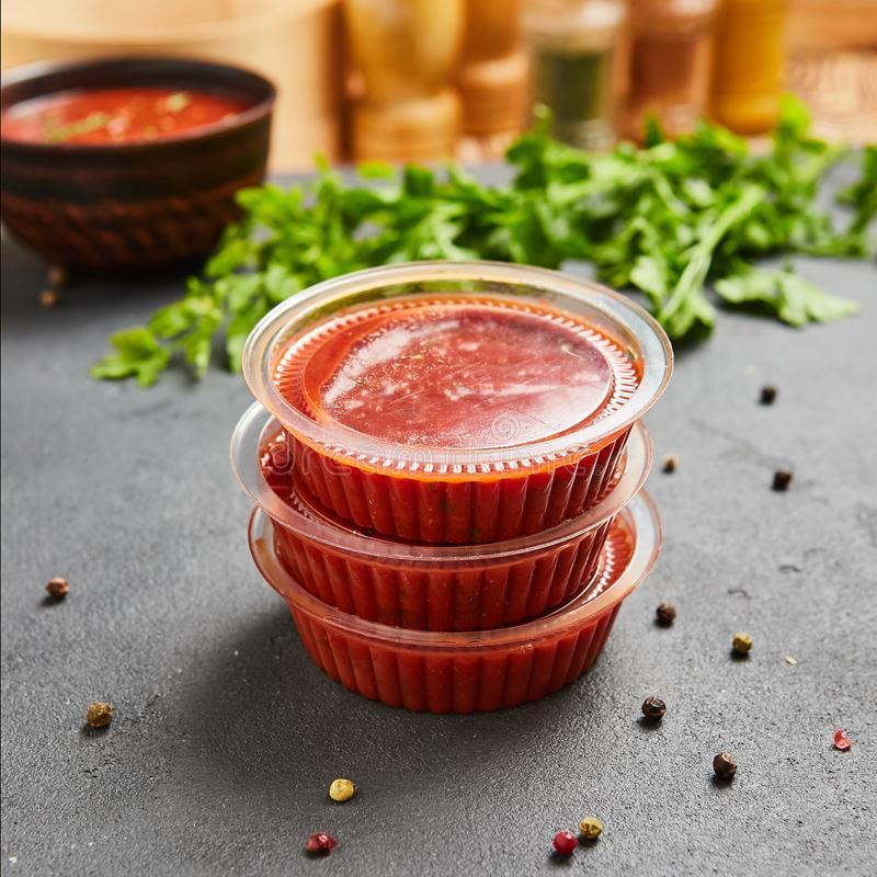 Satsebeli tomato ketchup sauce and paste with red hot chilly pepper, cilantro, garlic, vinegar, spices. Georgian traditional spicy royalty free stock photo