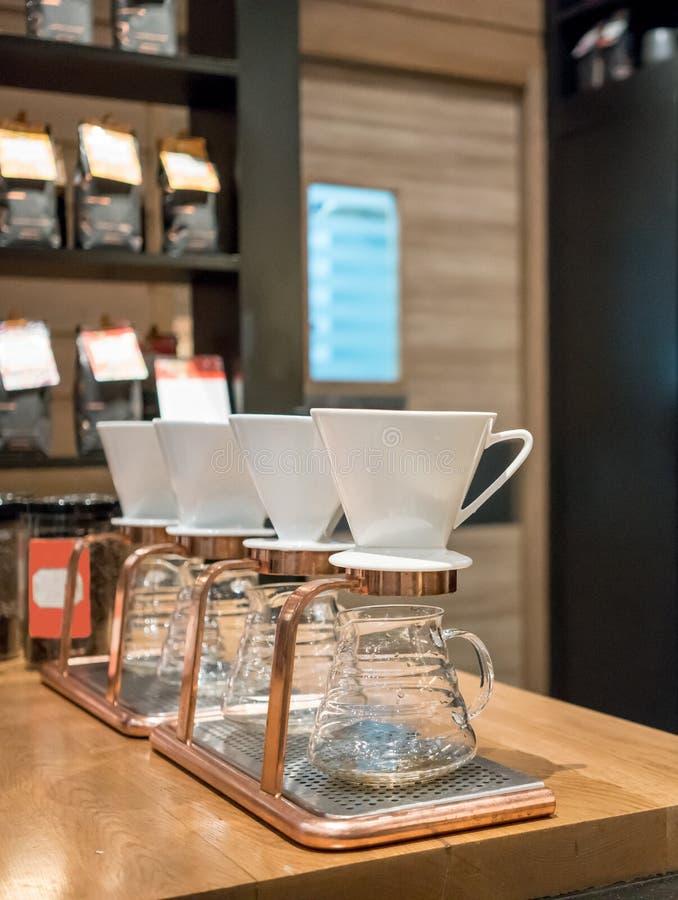 Satser för droppandekaffeexponeringsglas fotografering för bildbyråer