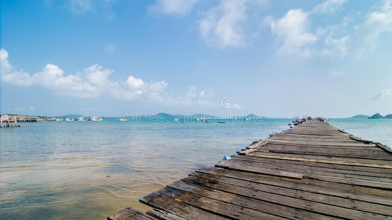 Sattahip, Thailand:Fishing boat at wooden pier royalty free stock image
