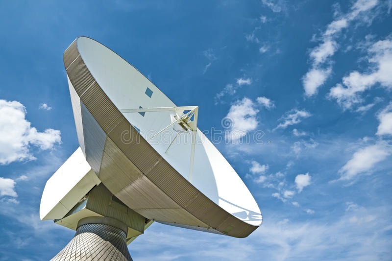 Sattelite dish. A photography of a sattelite dish and white cloud stock images