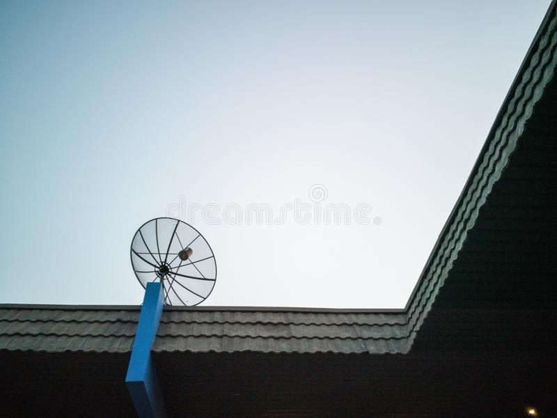 Sattlelite and TV antenna and Cellular communication antenna on the roof. royalty free stock photo