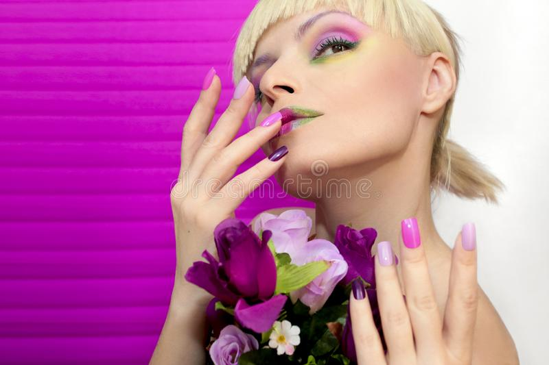 Saturated make-up. Summer manicure. Multi-colored make-up and manicure in pink lilac pastel colors. Saturated make-up. Summer manicure royalty free stock photos