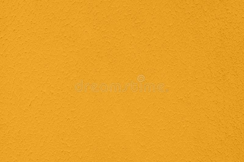 saturated yellow colored low contrast Concrete textured background with roughness and irregularities royalty free stock image