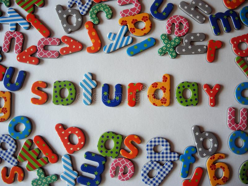 Saturday banner with colorful lower case letters stock photo