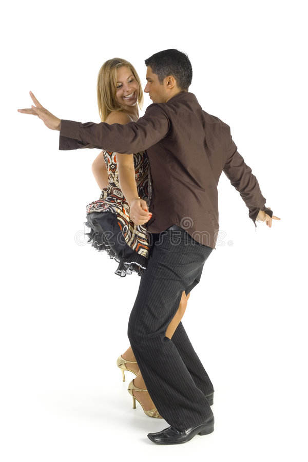 Saturday night fever. Dancing couple of young people. Smiling and looking at each other. Isolated on white in studio. Whole body, side view royalty free stock photography