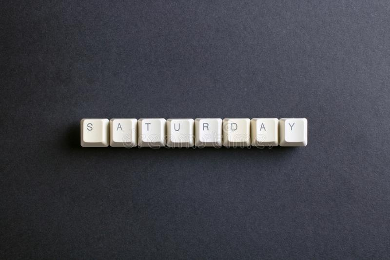 Saturday word on computer keys button. Flat lay view from above stock photography