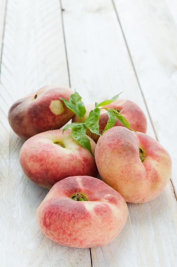 Saturn peaches or UFO, donut, flat peaches royalty free stock images