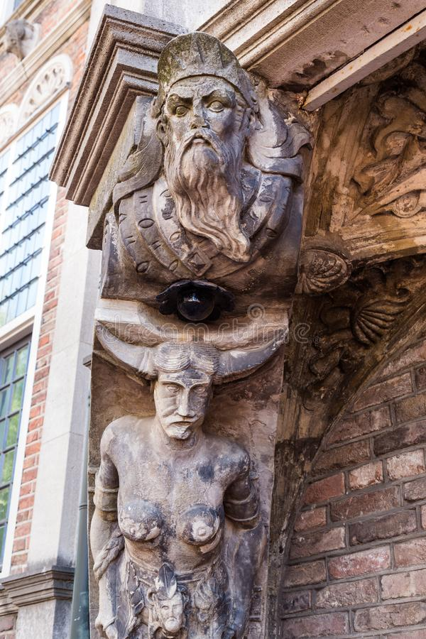 Satyr at the Devils house in Arnhem the Netherlands. Satyr sculptures at the City hall called Devils house or Maarten van Rossum house in Arnhem the Netherlands stock image
