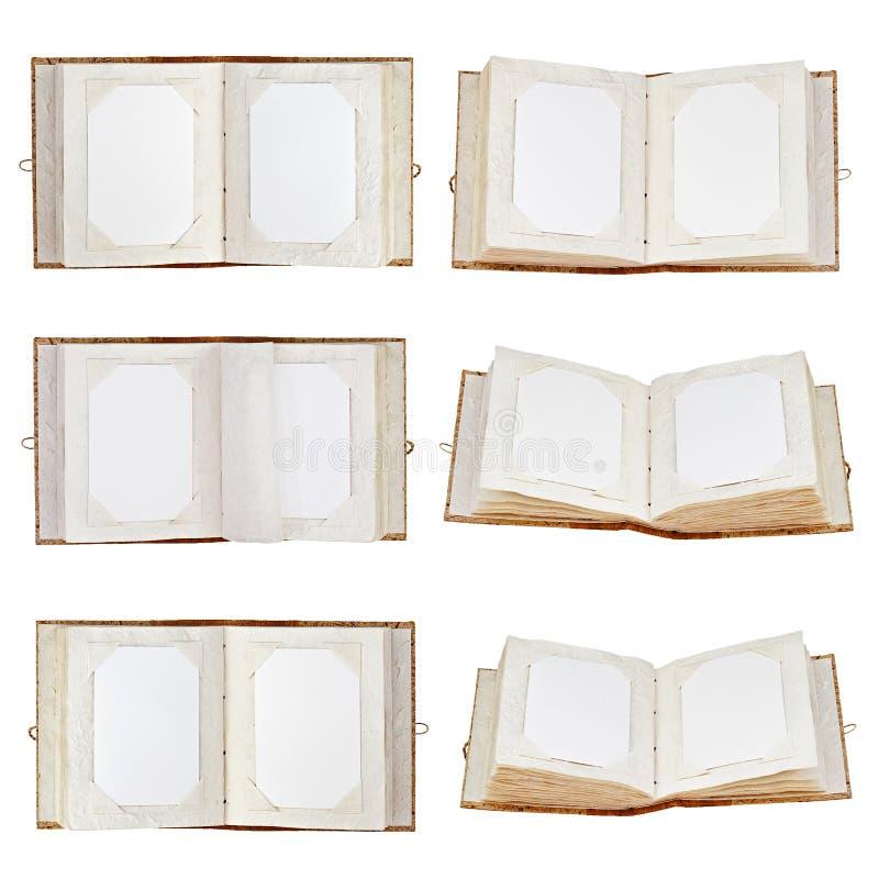 Satz alte offene Fotoalben lokalisiert auf weißem Hintergrund. stockbilder