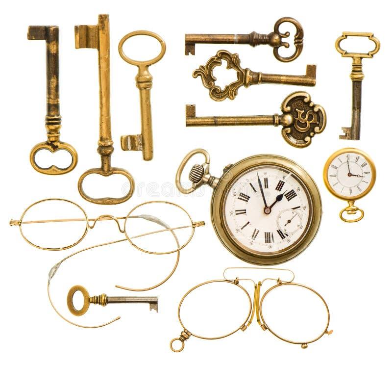 Satz antike Schlüssel, Uhr, Gläser lizenzfreie stockfotos