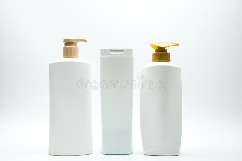 Satz der Shampoo- und Pflegespülungsplastikflasche mit Pumpe lizenzfreie stockfotos