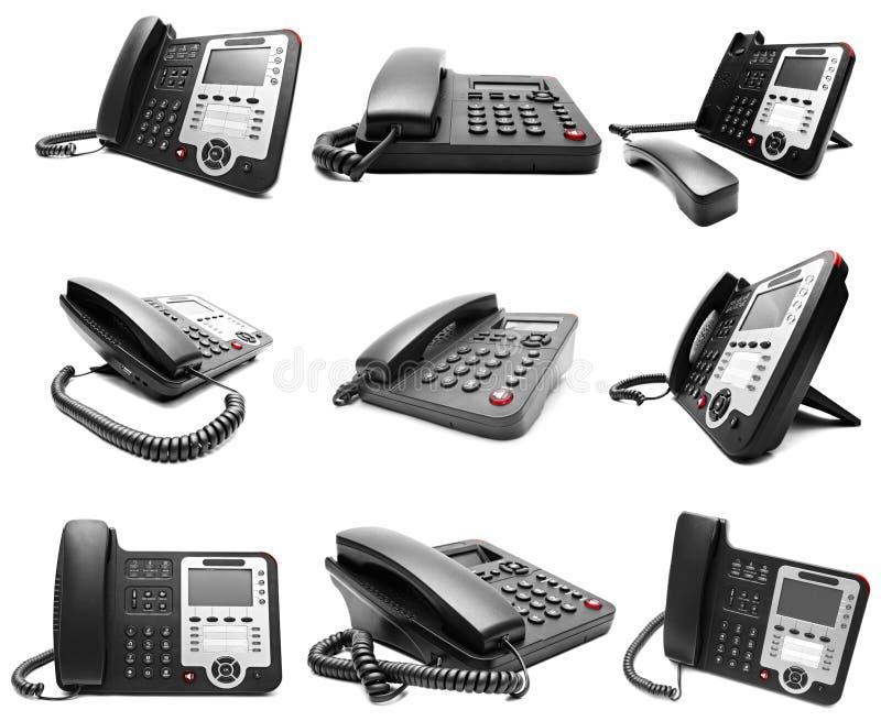 Satz des schwarzen IP-Bürotelefons lokalisiert lizenzfreies stockbild