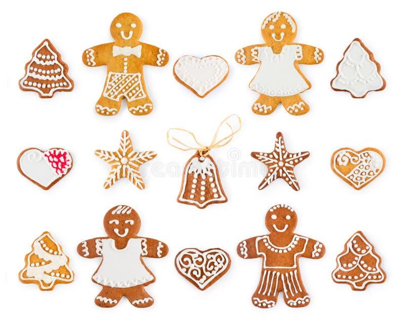 Satz des Weihnachtslebkuchens - süße Plätzchen in Form von Feiertagssymbolen und -gegenständen stockfotos