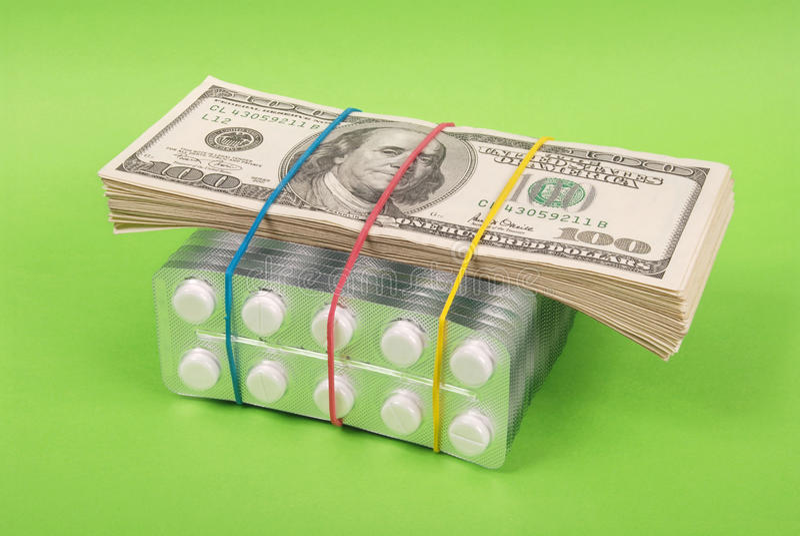 Satz Dollar legt auf Verpackung der weißen Tabletten lizenzfreie stockbilder