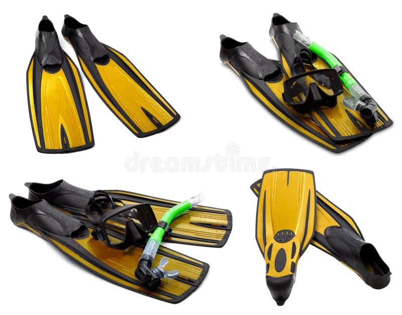 Satz gelbe Flipper, Maske, Schnorchel für das Tauchen mit Wassertropfen lizenzfreie stockfotos