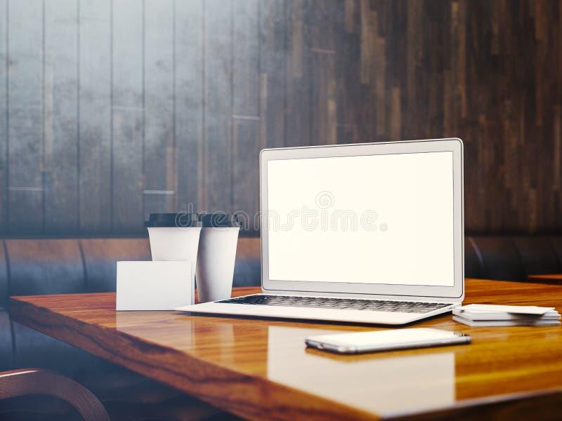 Satz generischer Designlaptop, businesscards, Smartphone und leere coffe Schalen auf dem Tisch im modernen Innenraum an stock abbildung